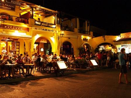 Crete to Rhodes - the romantic colours of the old town at night (image by Limntheu)