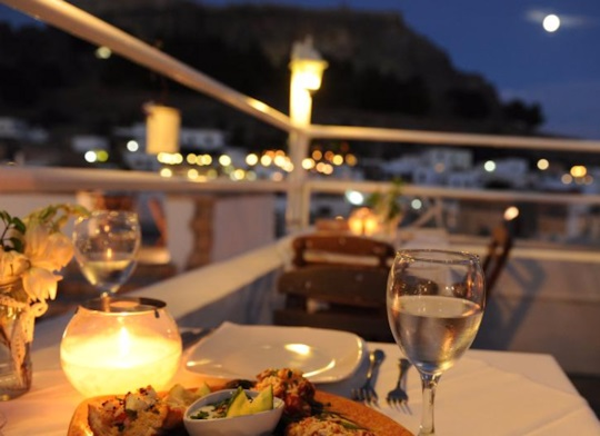 Enjoy a romantic evening for two in Lindos at Kalypso Restaurant, request seating on the rooftop