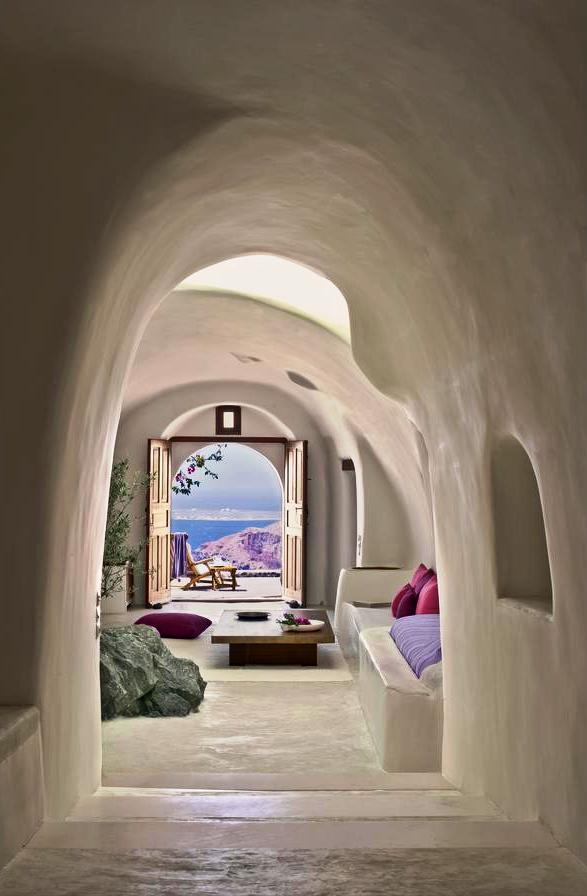 Experience the atmosphere of ancient Santorini by staying in a cave hotel. The modern hotels are very comfortable, nestled into the rock, with spectacular views. Such colours and perspective.