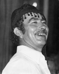A Cretan man wears a 'sariki' headscarf