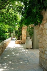 Sitia Spa Resort - exterior traditional walls and gardens