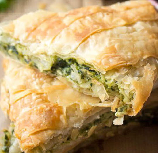 Slice of spanakopita - spinach and feta pie