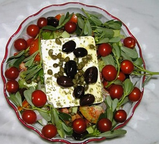 Fresh salad made by Evangelia - greens, olives, feta