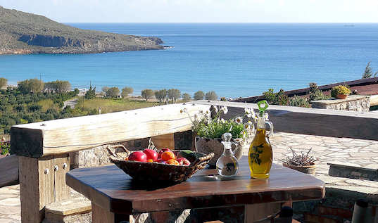 Terra Minoika Villas are made of local stone and wood and look over the bay at Kato Zakros