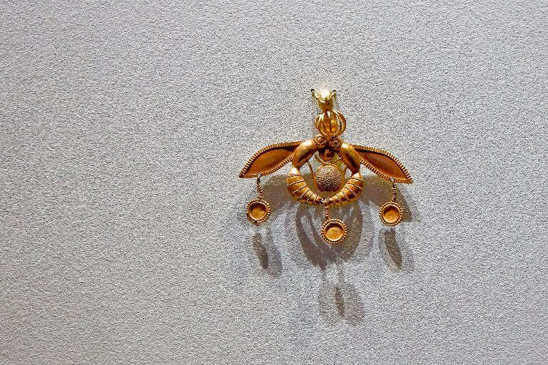 The Bee Pendant was discovered at Malia Palace ancient Minoan site and is displayed at the Heraklion Archaeological Museum