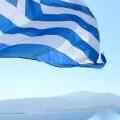 Info for Your Greek Holidays - picture of Greek flag off the back of the ferry