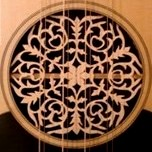 Music is central to life here - a laouto with detailed carving