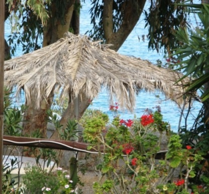 Azolimnos through the trees at our pension