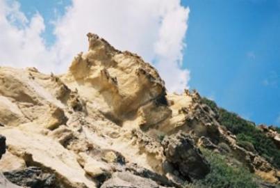 Rocky cliffs behind the beach