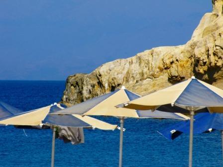 Summer sun and faded umbrellas