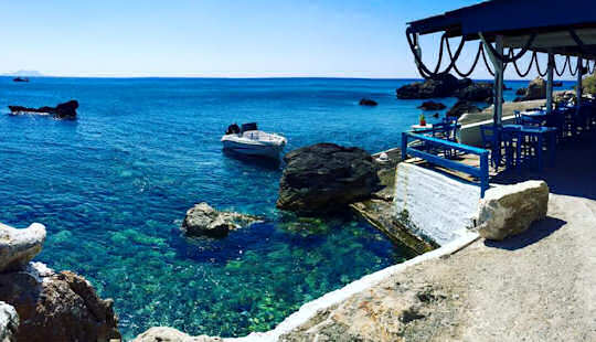 Sit and relax by the sea or swim at this tiny cove at Agia Fotia Taverna