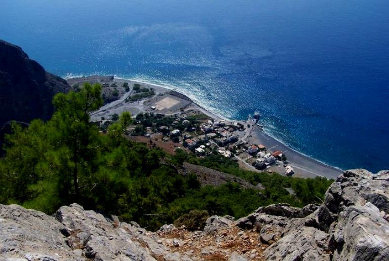 Walk through the gorge, crossing the mountains to the sea and arrive at Agia Roumeli on the south coast