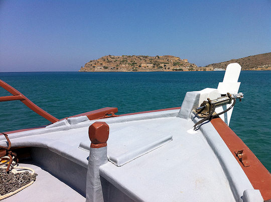 Take a boat to Spinalonga Island from Plaka or Elounda