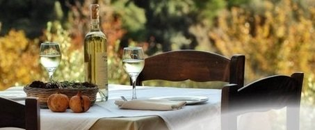 Crete Honeymoon - dinner table set for two with white wine