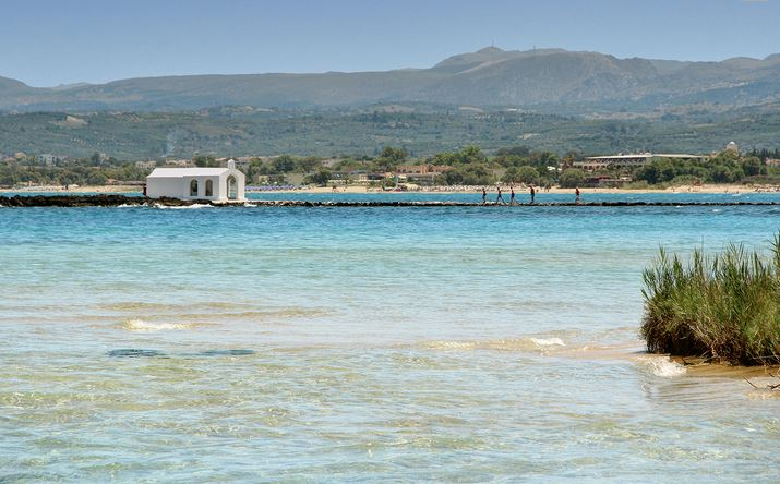 Georgioupolis Beach with its lovely seaside chapel is close to Lake Kournas