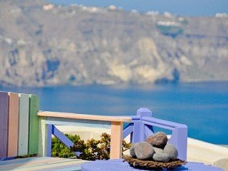 View across the caldera from your private Santorini balcony