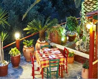 Kaliviani Traditional Hotel - a small family run comfortable place close to this beach - this shows the garden courtyard