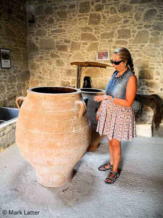 Ancient jars which were used to store olives and olive oil on display inside the Kamilari Fabrica