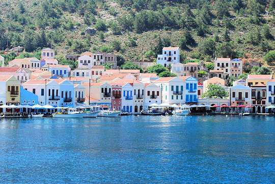 Kastellorizo Village homes are colourful and reflect on the clear waters of the harbour - life is full of time and show, restful days (image by Merle ja Joonas)