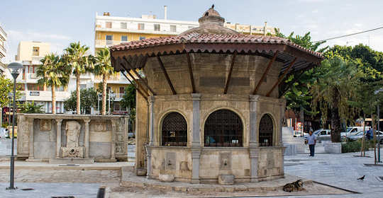 Kournaros Square in Heraklion shows some of the turbulent history of the island - in the foreground an old Turkish coffee house and in the background the partial remains of a Venetian Fountain