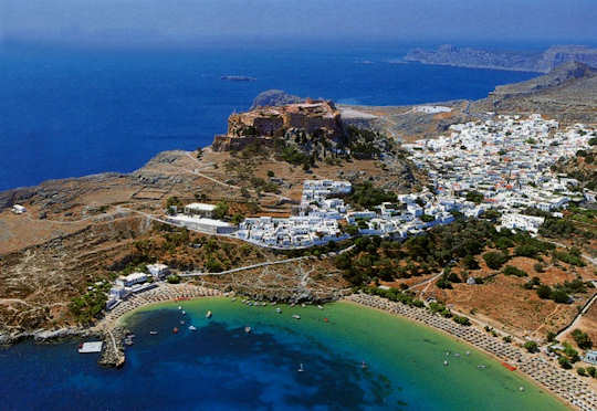 Lindos on Rhodes Island, showing the acropolis, the whitewashed village and surrounding coves with beaches