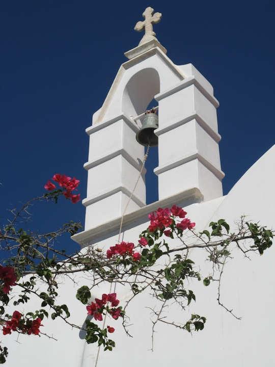 Mykonos white church spire with bougainvillea