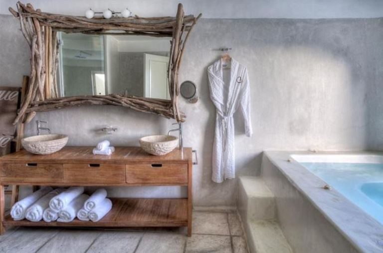 Mystique Boutique Hotel Santorini - rooms built in caves into the side of the volcano