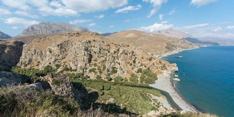 Preveli Beach has a hidden palm forest where the mouth of the gorge meets the sea