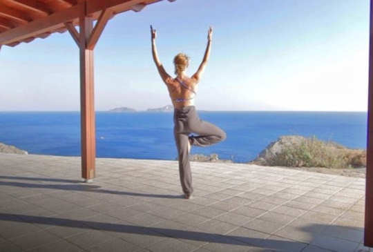 Yoga overlooking the sea in Crete