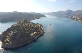 Spinalonga sits at the entrance to Elounda Bay, the site of a ruined Venetian fortress