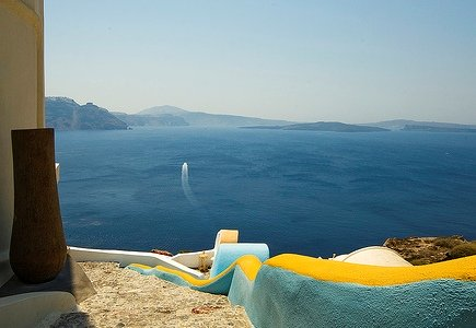 Santorini - steep sides of the caldera - coloured walkway and deep blue of the Med