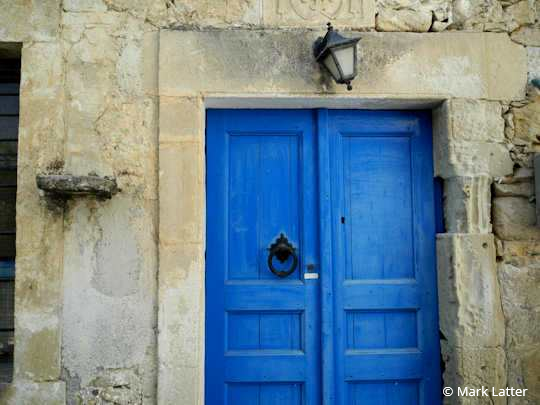 An old door with character in a small village in Crete