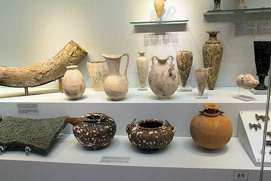 Elephant tusk from the Orient, copper ingots from Cyprus. Imported Egyptian vases modified by Minoans at Zakros, found in the Central Sanctuary Complex (Creative Commons Licensed image by Zde)